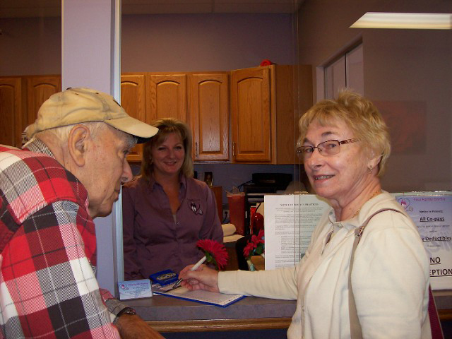 Couple signing in for an appointment for our health services in Belvidere, IL.